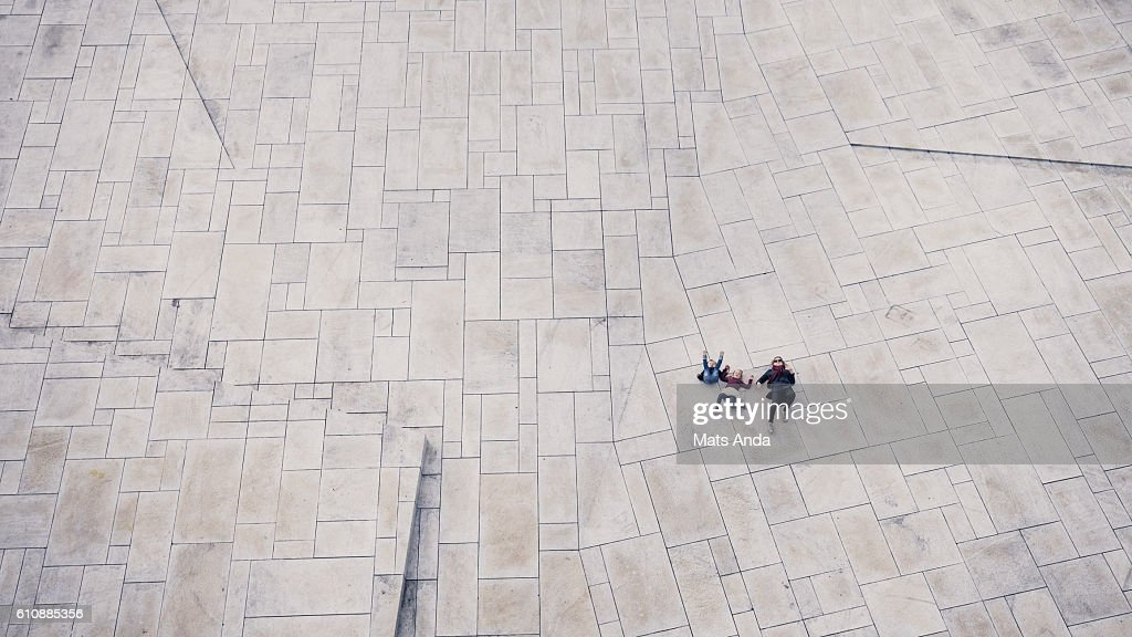 People lying on the ground : Stock Photo