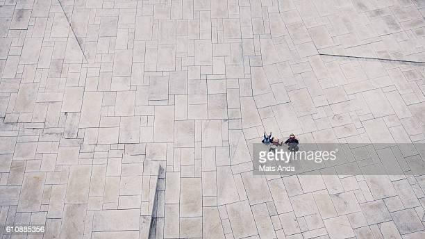 people lying on the ground - courtyard stock photos and pictures