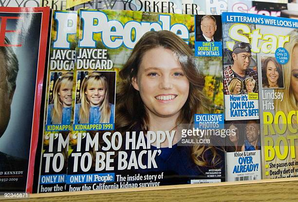 People Magazine's October 26 issue with recently freed kidnapping victim Jaycee Dugard on the cover appears on a newstand in Washington on October 16...
