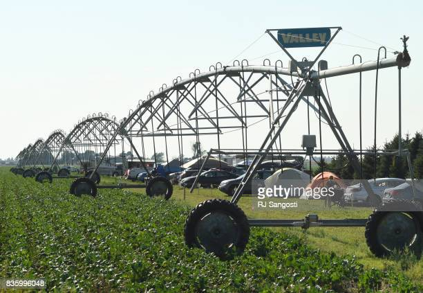 People make camp for the total solar eclipse along an irrigation pivot in a farmers field near Carhenge on August 20 2017 in Alliance Nebraska