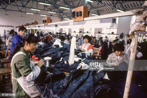 People make clothes at a factory Beijing China 1985