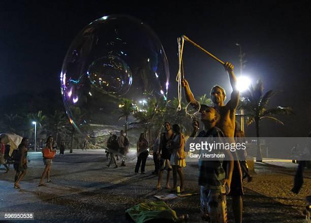 People make giant bubbles on Arpoador next to Ipanema Beach in Rio de Janeiro Brazil June 7 2014