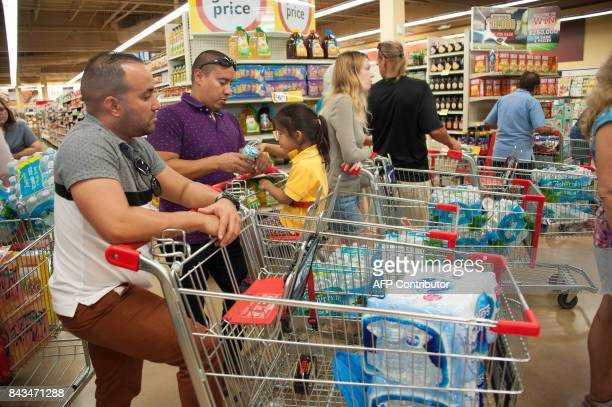 People make Hurricane Irma preparations at a Winn Dixie store in South Florida on September 6 2017 in Hallandale Florida Hurricane Irma one of the...
