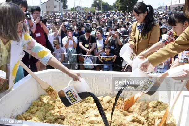 People make instant yakisoba stir fry noodles using a 13 meter by 18 meter metallic container in Isesaki city eastern Japan on May 5 breaking the...