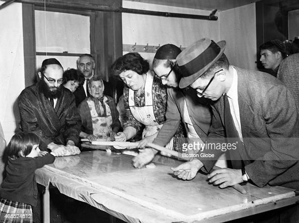 People make matzo by hand at New England Chassidic Center Congregation Beth Pinchas in Brookline Mass on April 18 1962