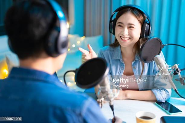 people make podcast in studio - television host stock pictures, royalty-free photos & images