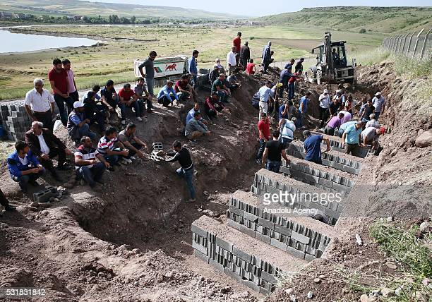 People make preparations before the funeral ceremony of the 13 victims, killed by PKK terrorist organization's bomb-laden truck attack in Sur...