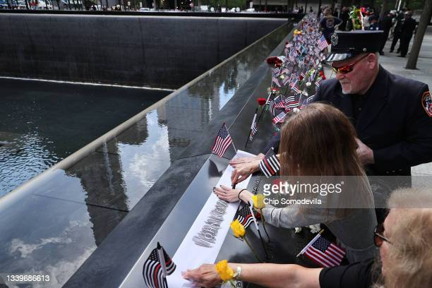 People make rubbings of the names of the victims of the 9/11 attacks and in the 1993 World Trade Center bombing that are inscribed along the memorial...