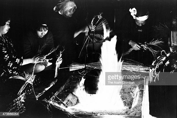 People make 'Shimenawa' sacred rope as a preparation for the New Year on December 10 1963 in Matsue Shimane Japan