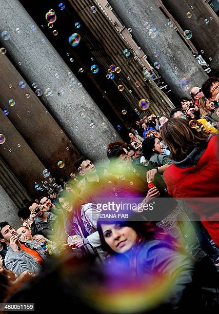 People make soap bubbles during a flash mob near the Pantheon on March 22 2014 in Rome AFP PHOTO / TIZIANA FABI