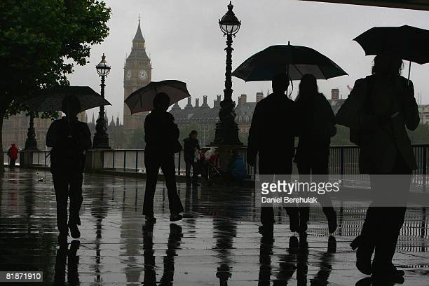 People make their way along Southbank on July 9 2008 in London England Heavy Summer rain has been forecast for the Southern England today