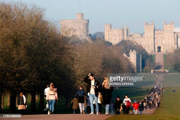 People make their way along The Long Walk as they exercise in Windsor, west of London, on January 9, 2021 as life continues under Britain's third...