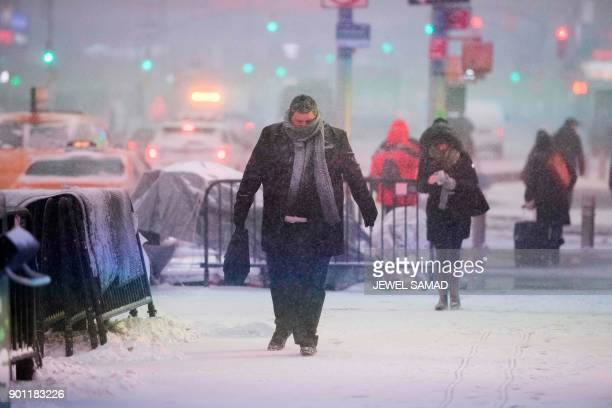 People make their way during a winter storm in New York on January 4 2018 The US National Weather Service warned that a major winter storm would...