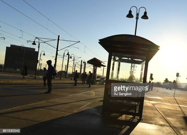 People make their way during the morning commute at the Federal Center Light Rail Station on March 13 2018 in Lakewood Colorado A plan for homeless...