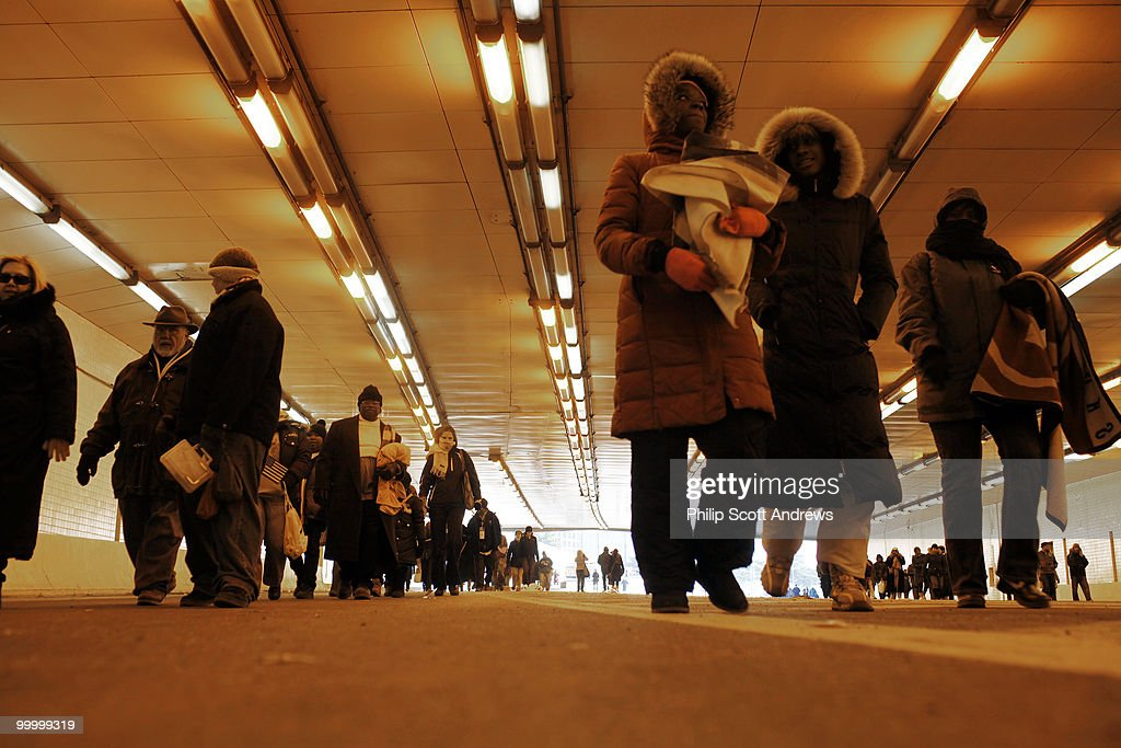 People make their way home through the I-95 tunnel after spending the day in sub-zero temperatures on the National Mall after the 56th Inauguration on January 20, 2009.