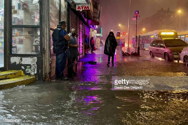 People make their way in rainfall from the remnants of Hurricane Ida on September 1 in the Bronx borough of New York City. The once category 4...