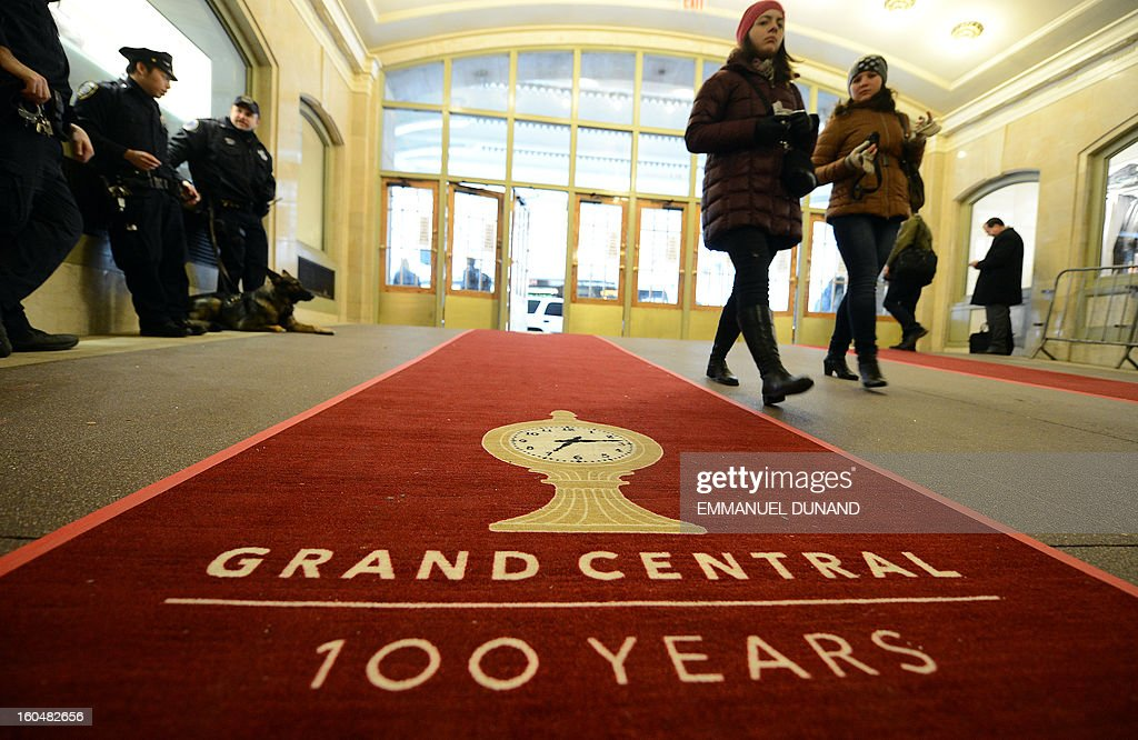 People make their way on a red carpet set up as part of the centennial celebrations for Grand Central Terminal in New York, February 1 , 2013 . Grand Central Terminal, the doyenne of US train stations, is celebrating its100th birthday on February 2, 2013. Opened on February 2, 1913, when trains were a luxurious means of traveling across America, the New York landmark with its Beaux-Arts facade is still one of the US largest transportation hubs and is also theNew York's second-most-popular tourist attraction, after Times Square. AFP PHOTO/Emmanuel Dunand