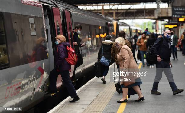People make their way on and off the Arriva Cross Country Train at Stoke-on-Trent Train Station on May 20, 2021 in Stoke, England. The British...