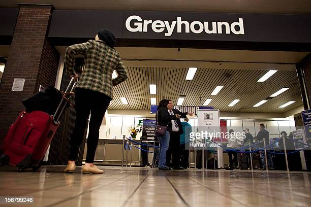 People make their way outside of a Greyhound Lines ticket office at the New York Port Authority bus terminal in Manhattan on November 21 2012 in New...