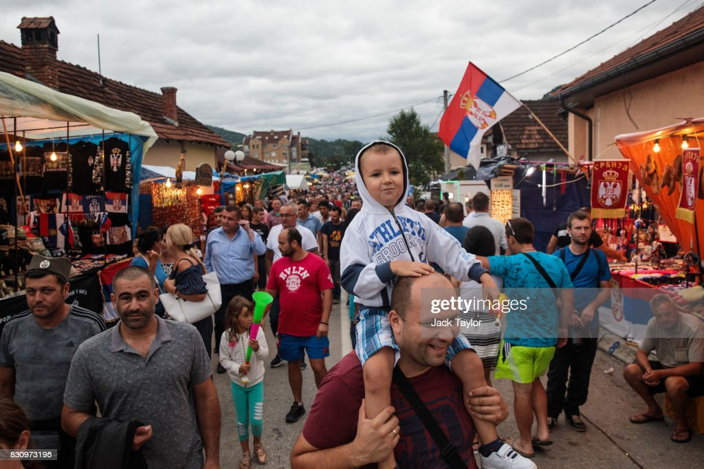 People make their way past stalls in the town during the Guca Trumpet Festival on August 12, 2017 in Guca, Serbia. Thousands of revellers attend the trumpet festival, held annually since 1961 in the small, central Serbian town of Guca. The free event is a celebration of Balkan music with dozens of orchestras and solo trumpeters taking part in the festival's main competition. During the festival wild street parties take place throughout the night as brass bands parade and play for tips to the thousands of visitors in the town's restaurants, bars and pop-up tents.