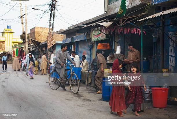 People make their way through a market place on March 17, 2009 in Rawalpindi, Pakistan. A suicide bomber detonated himself outside at a restaurant...