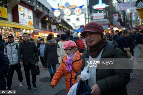 People make their way through Ameya Yokocho market on January 4 2018 in Tokyo Japan Ameya Yokocho claimed to be Tokyo's last remaining open air...