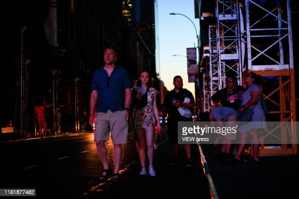 People make their way through the streets in Times Square during a major power outage on July 13 2019 in New York City New Yorkers were without power...
