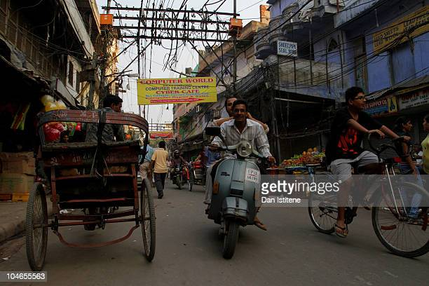 People make their way through the streets of Chandni Chowk market in Old Delhi on October 2 2010 in Delhi India Tourists are descending upon the...