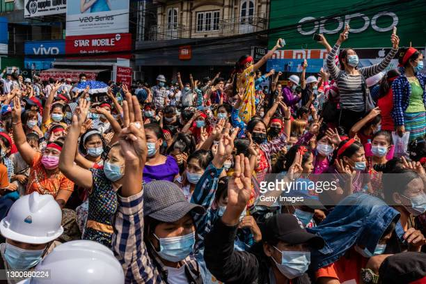 People make three-finger salutes during an anti-coup march on February 06, 2021 in Yangon, Myanmar. Myanmar's military junta on Saturday placed heavy...