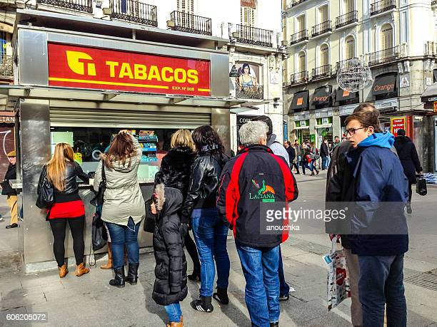 People making queue to buy cigarettes, Madrid, Spain