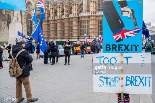People manifests against the Prime Minister Theresa May outside the Houses of Parliament in central London on January 17 2019 She was expected to win...