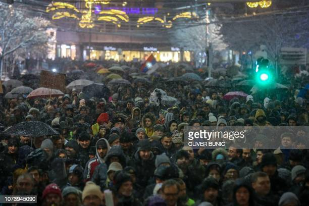 People many blowing whistles protest against violence and what they say is a crackdown by the government of President Aleksandar Vucic on opposition...