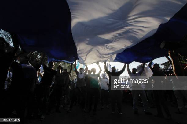 TOPSHOT People many who demand Nicaraguan President Daniel Ortega and his wife VicePresident Rosario Murillo to step down take part in the 'Walk for...