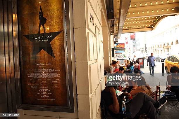 People, many who have been there for days, wait in line with dozens of others for tickets for the popular Broadway show Hamilton on June 21, 2016 in...