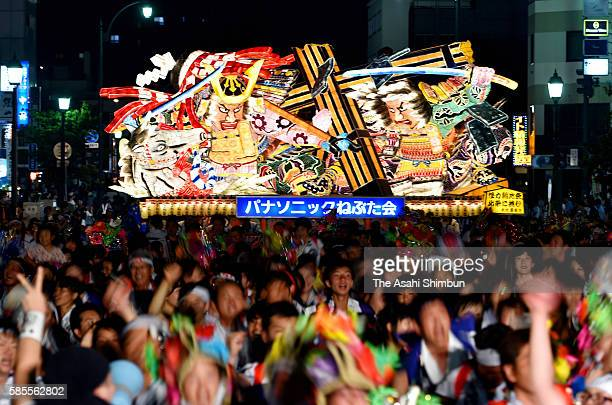People marach on with 'Nebuta' floats as the Aomori Nebuta Festival begins on August 2 2016 in Aomori Japan