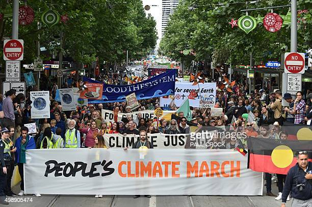 People march along a road during a rally calling for action on climate change in Melbourne on November 27 2015 From school children to the elderly...