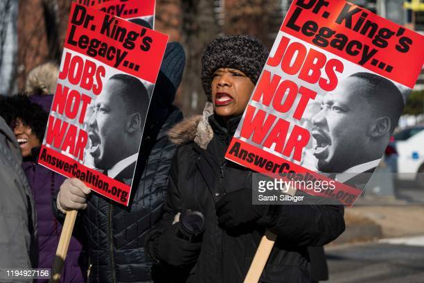 People march along Martin Luther King Jr Ave SE during a Martin Luther King Jr Day parade on January 20 2020 in Washington DC First observed 34 years...