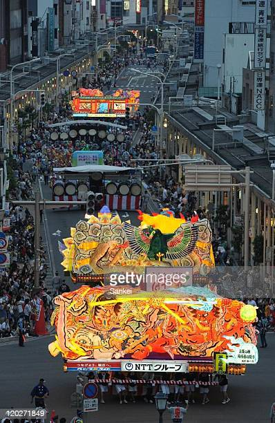 People march alongside five meter high floats on a street during the Aomori Nebuta Festival on August 2 2011 in Aomori Japan