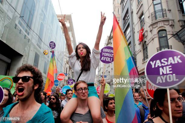 People march and chant slogans during a gay parade on Istiklal Street the main shopping corridor on June 30 2013 in Istanbul during the fourth Trans...