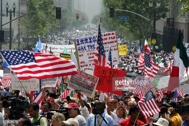 People march and rally on what is being dubbed a Day Without Immigrants or the Great American Boycott day on May 1 2006 in Los Angeles California...