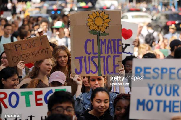 People march as they take part in a strike to demand action on the global climate crisis on September 20, 2019 in New York City. In what could be the...