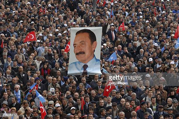 People march behind the hearse carrying the coffin of former Turkish Prime Minister Bulent Ecevit during his funeral on November 11 2006 in Ankara...