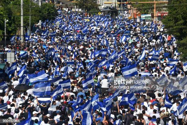 People march demanding Nicaraguan President Daniel Ortega and his wife VicePresident Rosario Murillo step down even though the government revoked a...