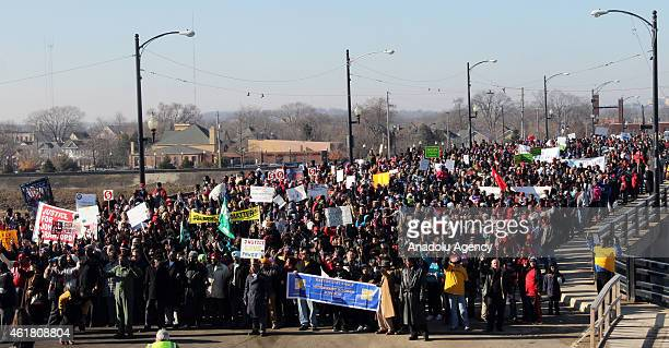 People march down during a Martin Luther King Jr day demonstration on January 19 2015 in Dayton Ohio Martin Luther King day was marked by many...