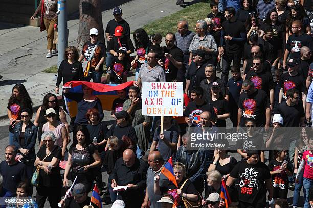 People march down Hollywood Boulevard on the 99th anniversary of the Armenian Genocide, calling for recognition and reparations, on April 24, 2014 in...