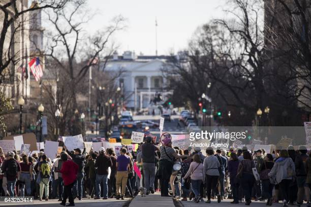 People march down Massachusetts Avenue to the White House to protest President Trump and his policies in a demonstration called Not My President's...
