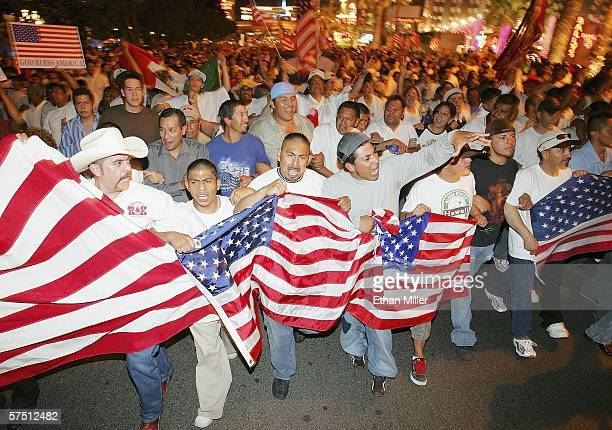 People march down the Las Vegas Strip in support of immigrant rights as part of a Day Without Immigrants on May 1 2006 in Las Vegas Nevada An...