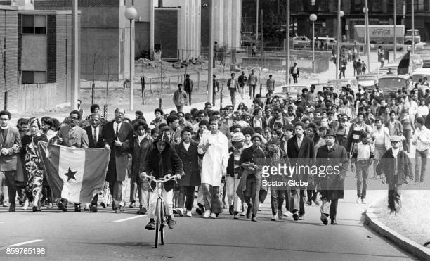 """People march down Townsend Street to a """"resurrection service"""" for Dr. Martin Luther King Jr. In the Roxbury neighborhood of Boston, April 4, 1969."""