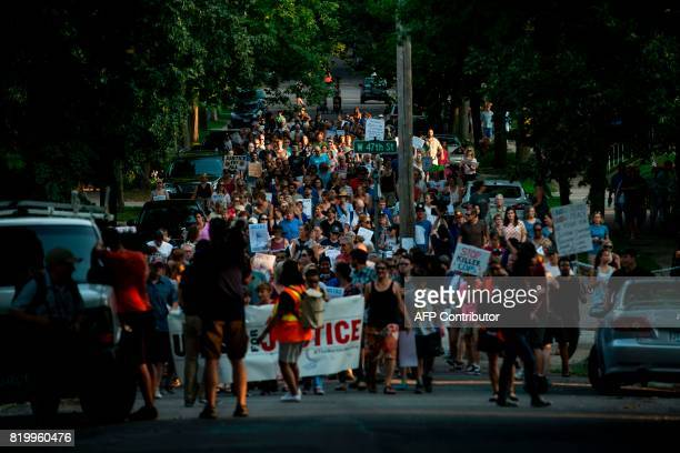 People march down Washburn Avenue on July 20 2017 in Minneapolis Minnesota Several days of demonstrations have occurred after the death of Justine...