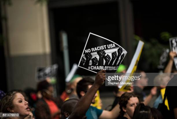 People march downtown to protest racism and the violence over the weekend in Charlottesville Virginia on August 14 2017 in Minneapolis Minnesota...